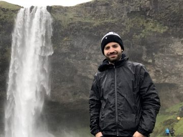 Getting soaked under a waterfall in Iceland